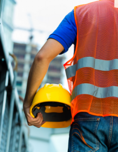 construction worker with hard hat article illustration Most dangerous industries for catastrophic injury