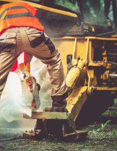 Construction worker with heavy equipment article illustration most dangerous industries for catastrophic injury