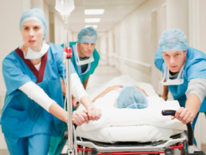 patient on gurney in hospital - illustration-when is a workplace injury catastrophic