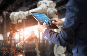 employer using smart tablet in industrial plant - article illustration Understanding your employers responsibilities under OSHA