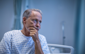 worried man on hospital bed - article illustration